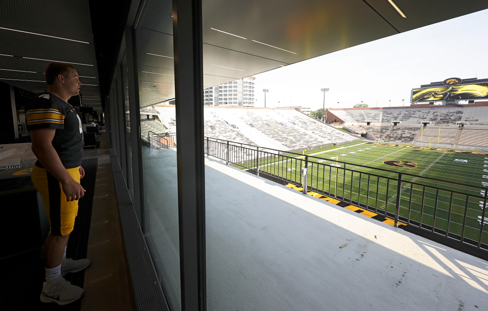 Iowa Hawkeyes quarterback Nate Stanley (4) looks at the field from the new Ted Pacha Family Club at Kinnick Stadium in Iowa City on Friday, Aug 9, 2019. (Stephen Mally/hawkeyesports.com)
