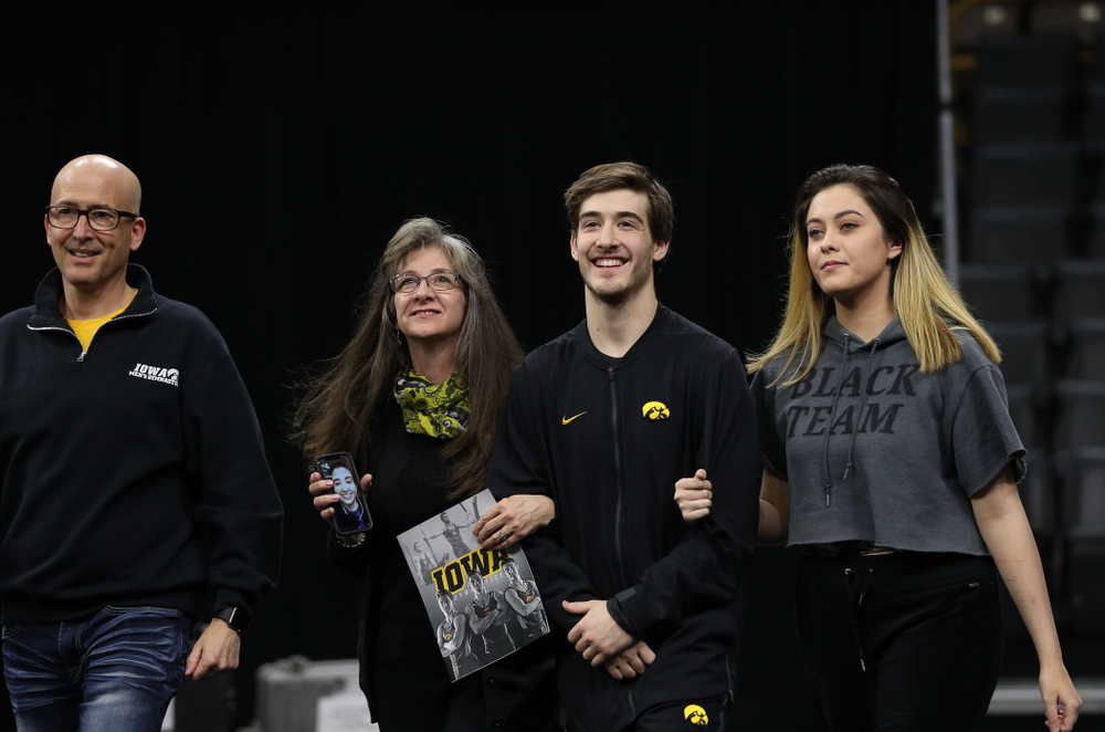 Iowa Men's Gymnast Kevin Johnson and his family during senior day ceremonies following their meet against the Ohio State Buckeyes  Saturday, March 16, 2019 at Carver-Hawkeye Arena.  (Brian Ray/hawkeyesports.com)