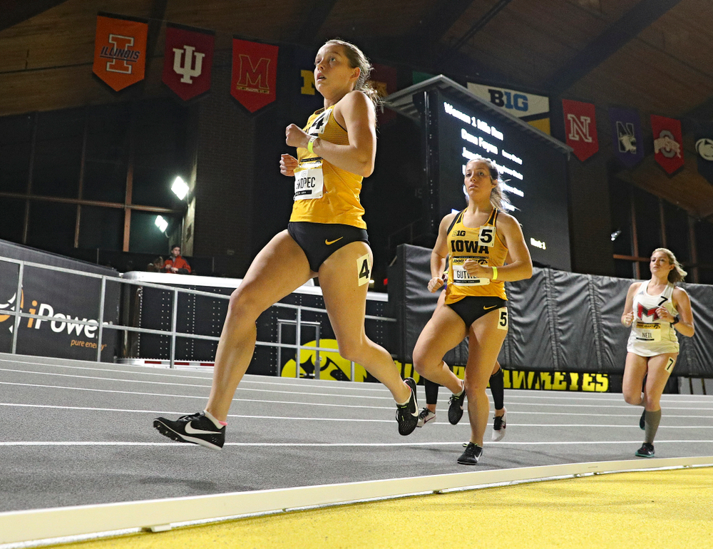 Iowa's Gabby Skopec (from left) and Maggie Gutwein run the women's 1 mile run event during the Jimmy Grant Invitational at the Recreation Building in Iowa City on Saturday, December 14, 2019. (Stephen Mally/hawkeyesports.com)