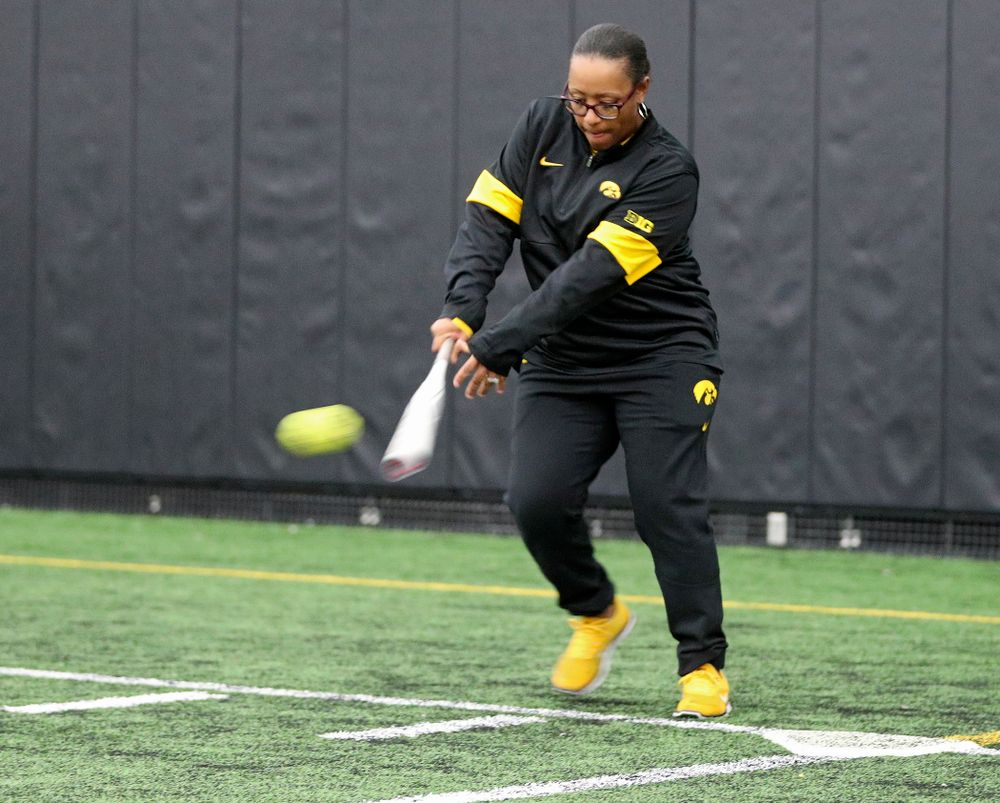 Iowa assistant coach Trena Prater hits a ball during practice at Iowa Softball Media Day at the Hawkeye Tennis and Recreation Complex in Iowa City on Thursday, January 30, 2020. (Stephen Mally/hawkeyesports.com)