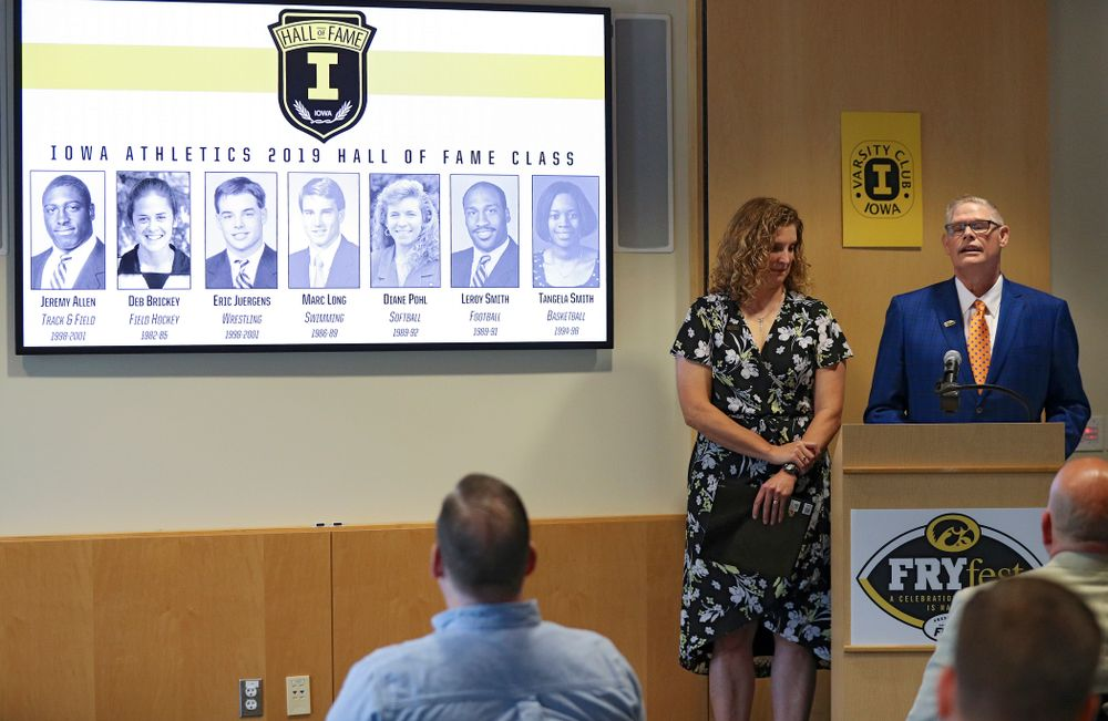 Barb Randall (from left), Iowa Varsity Club Co-Chair, and Lon Olejniczak, Iowa Varsity Club Co-Chair, announce the 2019 Iowa Athletics Hall of Fame members in the Varsity Club Room at the University of Iowa Athletics Hall of Fame in Iowa City on Tuesday, Jun 11, 2019. (Stephen Mally/hawkeyesports.com)