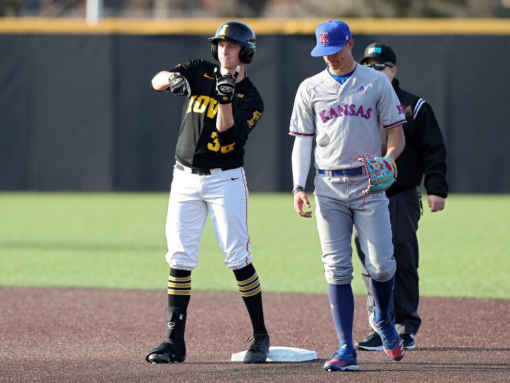 Iowa designated hitter Trenton Wallace (38) celebrates after hitting an RBI double during the third inning of their college baseball game at Duane Banks Field in Iowa City on Tuesday, March 10, 2020. (Stephen Mally/hawkeyesports.com)