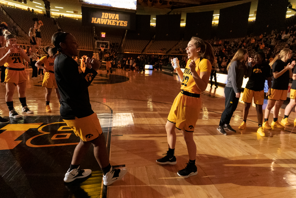 Iowa Hawkeyes guard Zion Sanders (24) and guard Kathleen Doyle (22) against the Michigan State Spartans Thursday, February 7, 2019 at Carver-Hawkeye Arena. (Brian Ray/hawkeyesports.com)