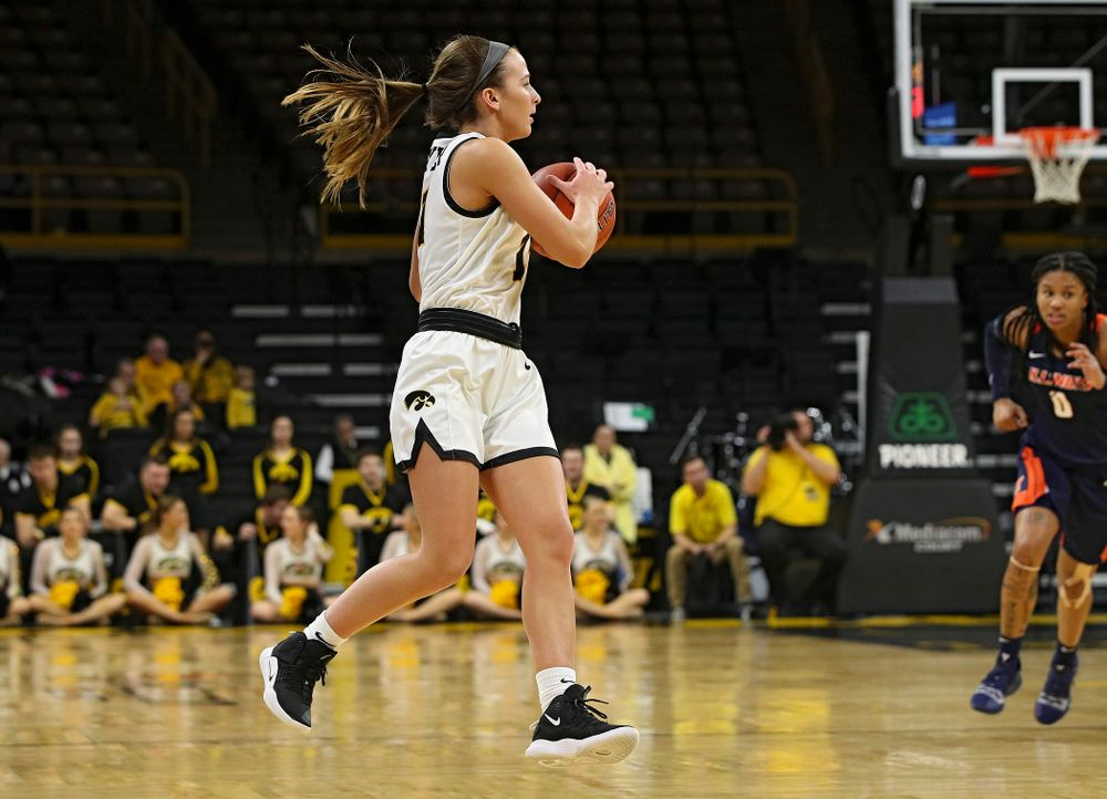 Iowa Hawkeyes guard Megan Meyer (11) pulls in a pass during the fourth quarter of their game at Carver-Hawkeye Arena in Iowa City on Tuesday, December 31, 2019. (Stephen Mally/hawkeyesports.com)
