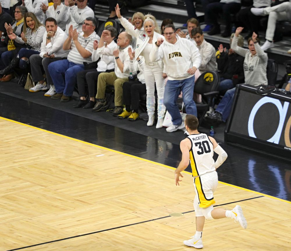 Iowa Hawkeyes guard Connor McCaffery (30) runs down the court after making a 3-pointer during the first quarter of the game at Carver-Hawkeye Arena in Iowa City on Sunday, February 2, 2020. (Stephen Mally/hawkeyesports.com)