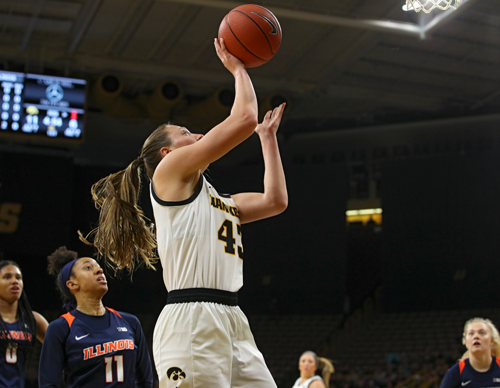 Iowa Hawkeyes forward Amanda Ollinger (43) scores a basket inside during the first quarter of their game at Carver-Hawkeye Arena in Iowa City on Tuesday, December 31, 2019. (Stephen Mally/hawkeyesports.com)