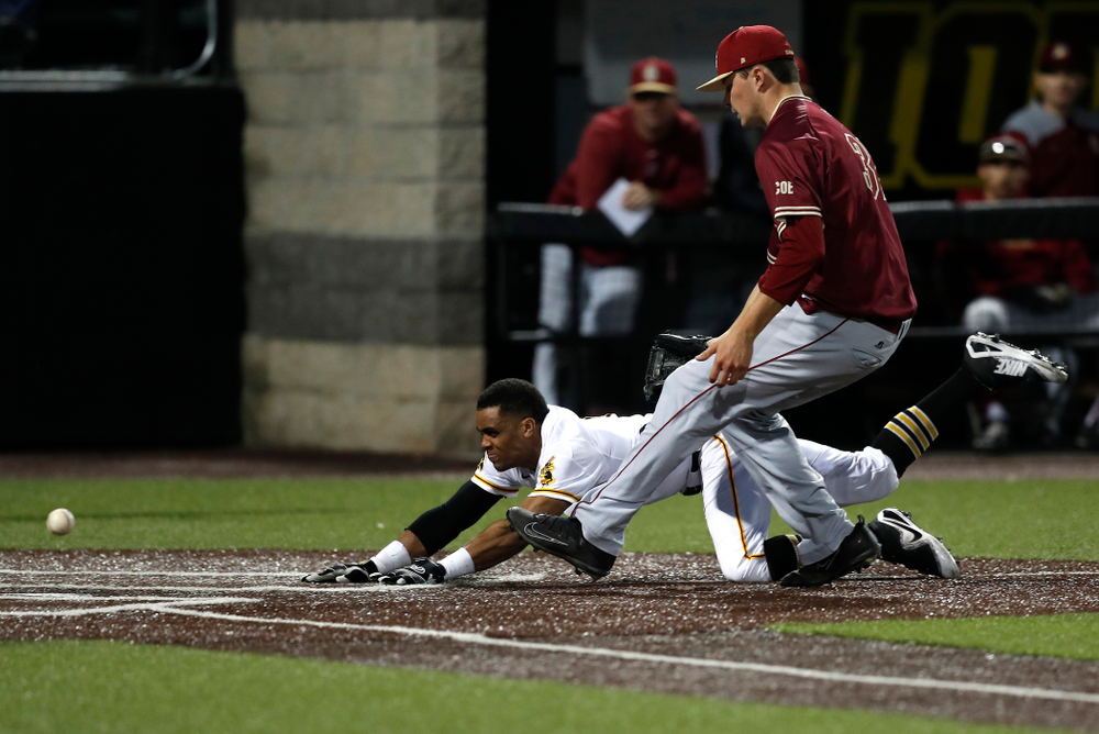Iowa Hawkeyes third baseman Lorenzo Elion (1) scores against Coe College Wednesday, April 11, 2018 at Duane Banks Field. (Brian Ray/hawkeyesports.com)