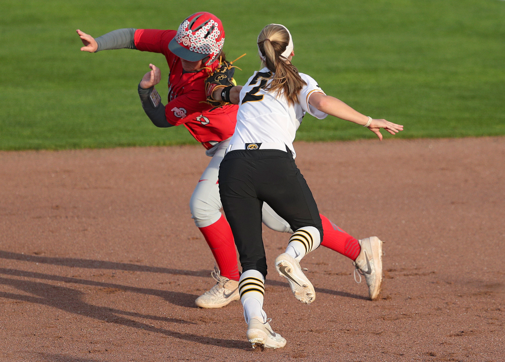 Iowa second baseman Aralee Bogar (2) tags out a runner as she turns an inning ending double play during the sixth inning of their game against Ohio State at Pearl Field in Iowa City on Friday, May. 3, 2019. (Stephen Mally/hawkeyesports.com)
