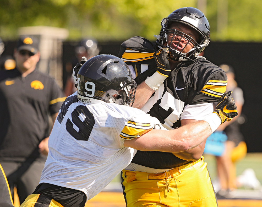Iowa Hawkeyes linebacker Nick Niemann (49) and offensive lineman Alaric Jackson (77) run a drill during Fall Camp Practice #5 at the Hansen Football Performance Center in Iowa City on Tuesday, Aug 6, 2019. (Stephen Mally/hawkeyesports.com)