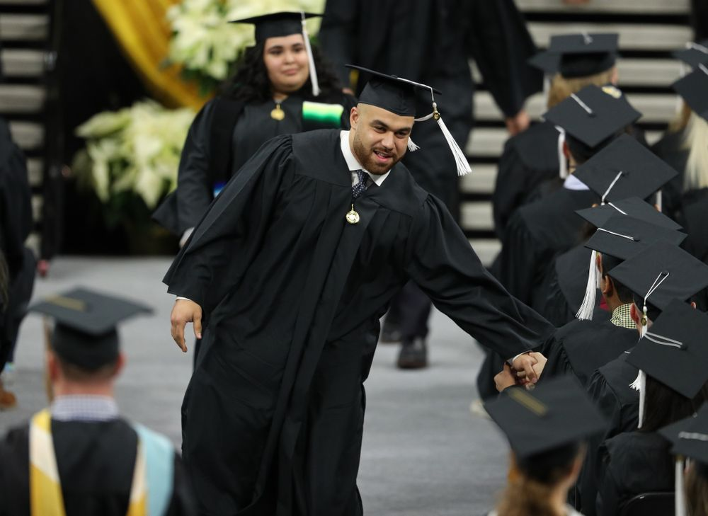 Iowa Football's Austin Kelly during the Fall Commencement Ceremony  Saturday, December 15, 2018 at Carver-Hawkeye Arena. (Brian Ray/hawkeyesports.com)