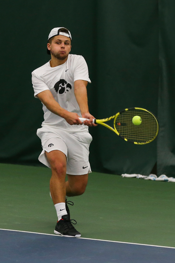 Iowa's Will Davies hits a forehand during the Iowa men's tennis match vs Western Michigan on Saturday, January 18, 2020 at the Hawkeye Tennis and Recreation Complex. (Lily Smith/hawkeyesports.com)