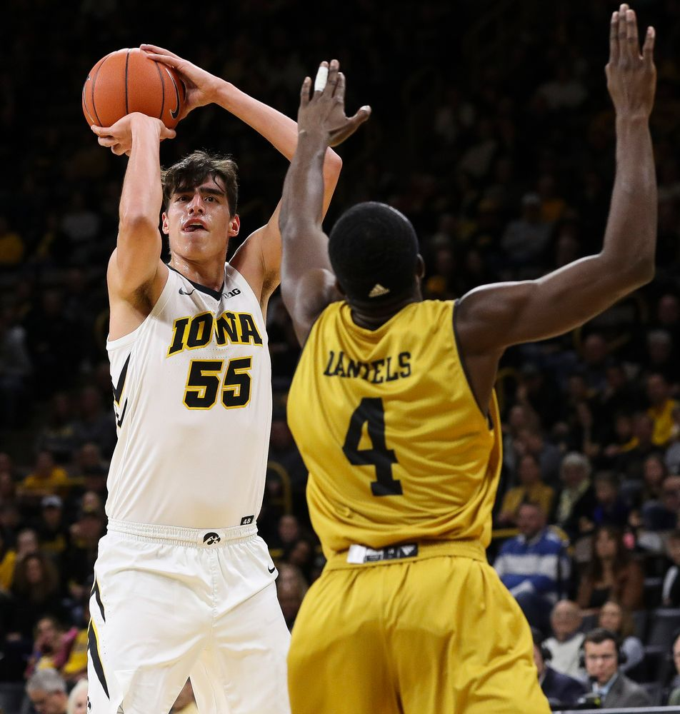 Iowa Hawkeyes forward Luka Garza (55) shoots a 3-pointer during a game against Alabama State at Carver-Hawkeye Arena on November 21, 2018. (Tork Mason/hawkeyesports.com)