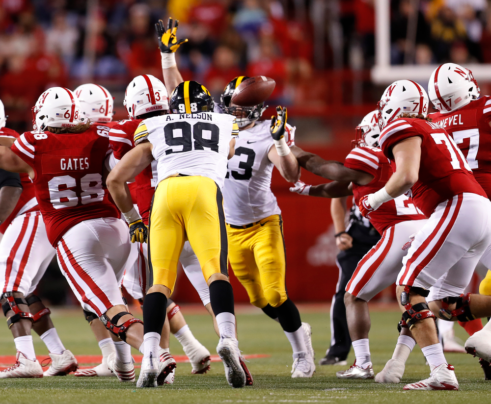 Iowa Hawkeyes defensive end Anthony Nelson (98) and linebacker Josey Jewell (43)