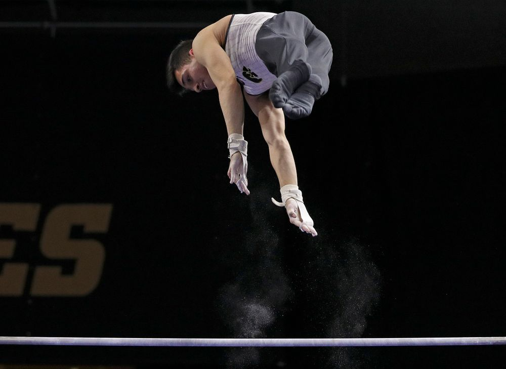 Iowa's Andrew Herrador competes in the parallel bars during the second day of the Big Ten Men's Gymnastics Championships at Carver-Hawkeye Arena in Iowa City on Saturday, Apr. 6, 2019. (Stephen Mally/hawkeyesports.com)