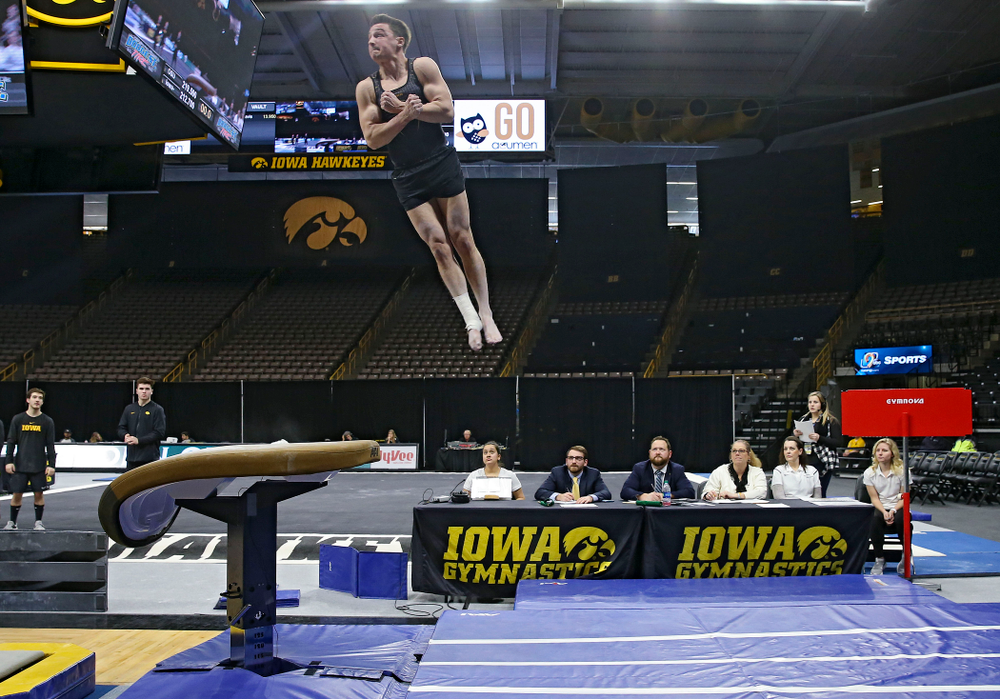 Iowa's Jake Brodarzon competes in the vault against Ohio State at Caver-Hawkeye Arena in Iowa City on Saturday, Mar. 16, 2019. (Stephen Mally for HawkeyeSports.com)