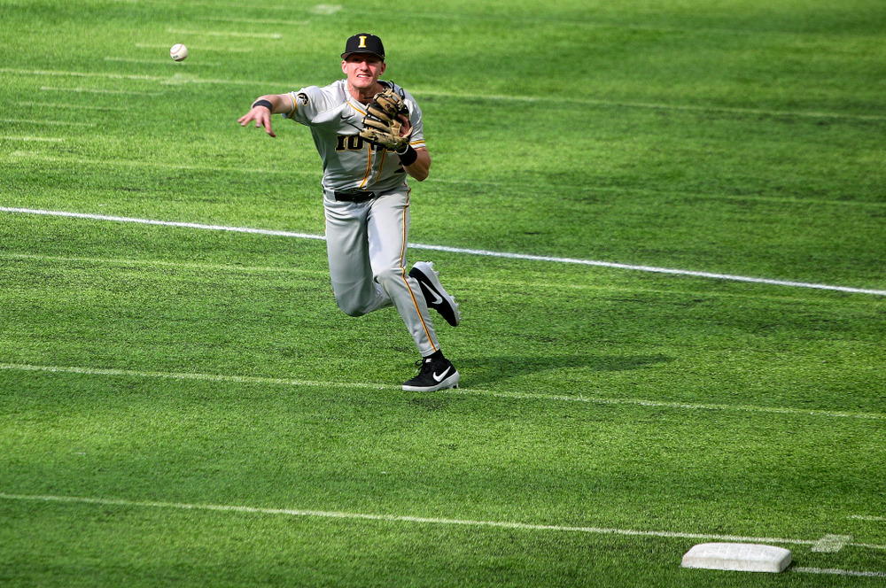 Iowa Hawkeyes infielder Brendan Sher (2) throws to first during the first inning of their CambriaCollegeClassic game at U.S. Bank Stadium in Minneapolis, Minn. on Friday, February 28, 2020. (Stephen Mally/hawkeyesports.com)