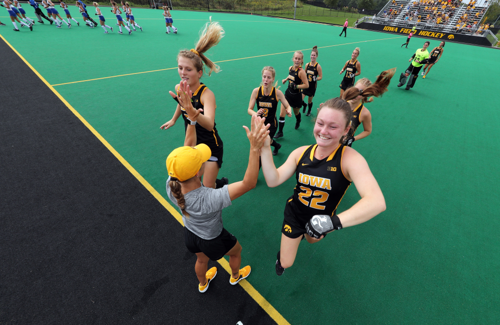 Iowa Hawkeyes Ellie Holley (7) and defenseman Ellie Flynn (22) slap hands with assistant coach Roz Ellis before their game against the Duke Blue Devils Sunday, September 15, 2019 at Grant Field.  (Brian Ray/hawkeyesports.com)