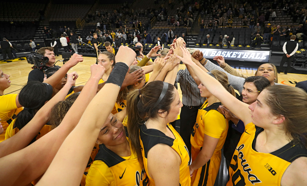 The Hawkeyes huddle after winning their game against Winona State at Carver-Hawkeye Arena in Iowa City on Sunday, Nov 3, 2019. (Stephen Mally/hawkeyesports.com)