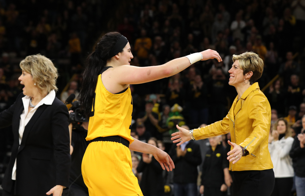 Iowa Hawkeyes forward Megan Gustafson (10) and associate head coach Jan Jensen during senior day ceremonies following their game against the Northwestern Wildcats Sunday, March 3, 2019 at Carver-Hawkeye Arena. (Brian Ray/hawkeyesports.com)