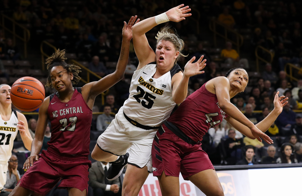 Iowa Hawkeyes forward Monika Czinano (25) is fouled in the act of shooting during a game against North Carolina Central at Carver-Hawkeye Arena on November 17, 2018. (Tork Mason/hawkeyesports.com)