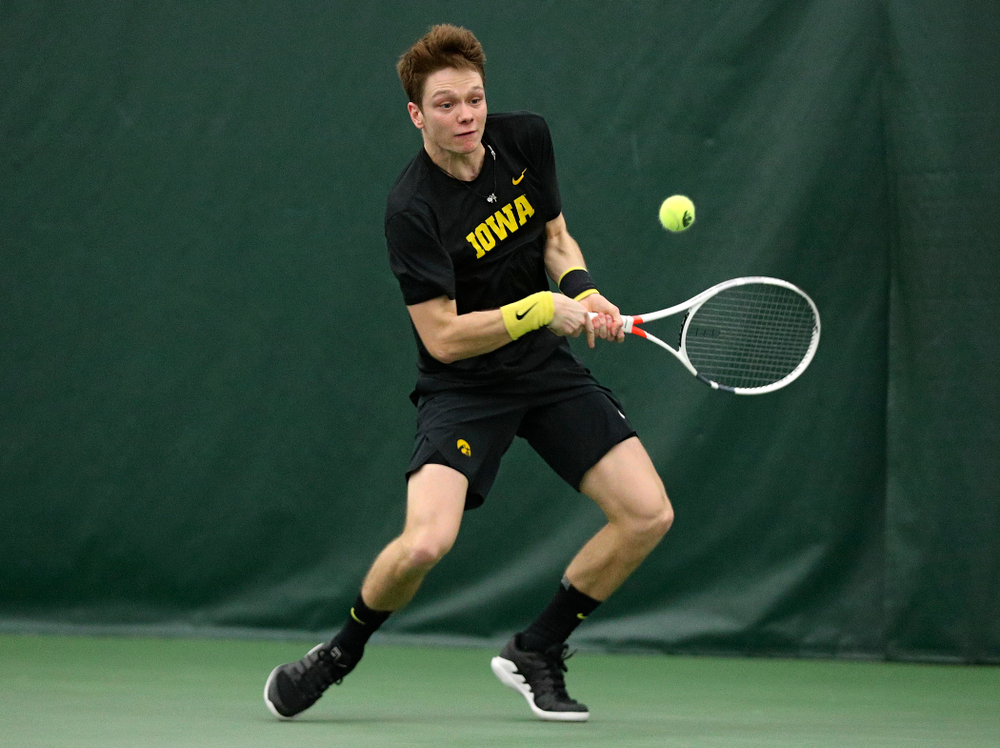 Iowa's Jason Kerst returns a shot during his singles match at the Hawkeye Tennis and Recreation Complex in Iowa City on Friday, March 6, 2020. (Stephen Mally/hawkeyesports.com)