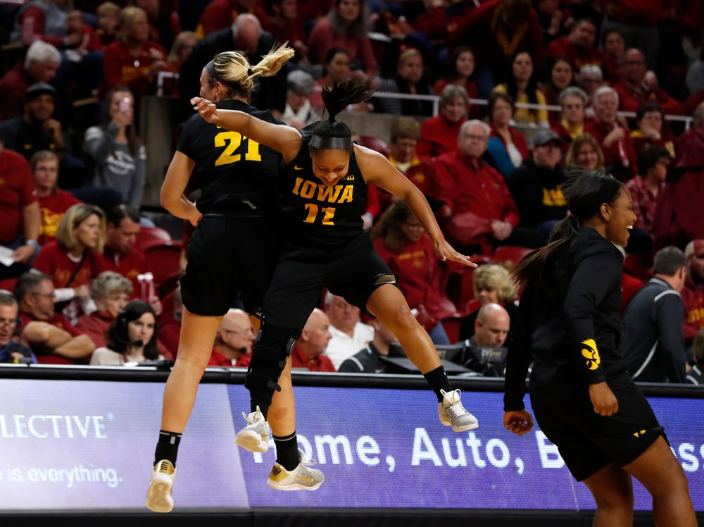 Iowa Hawkeyes forward Hannah Stewart (21) and guard Tania Davis (11)