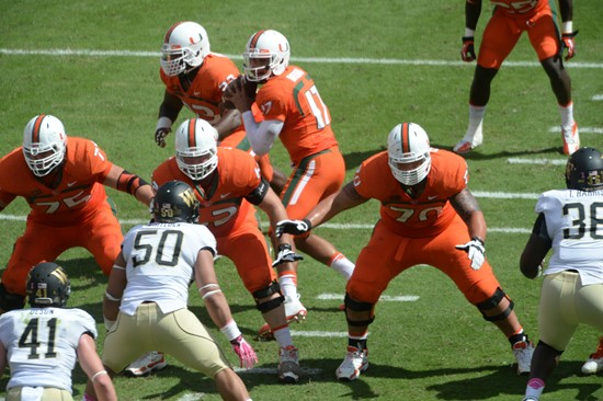 University of Miami Hurricanes offensive line gets set to block for Stephen Morris in a game against the Wake Forest Demon Deacons at Sun Life Stadium...