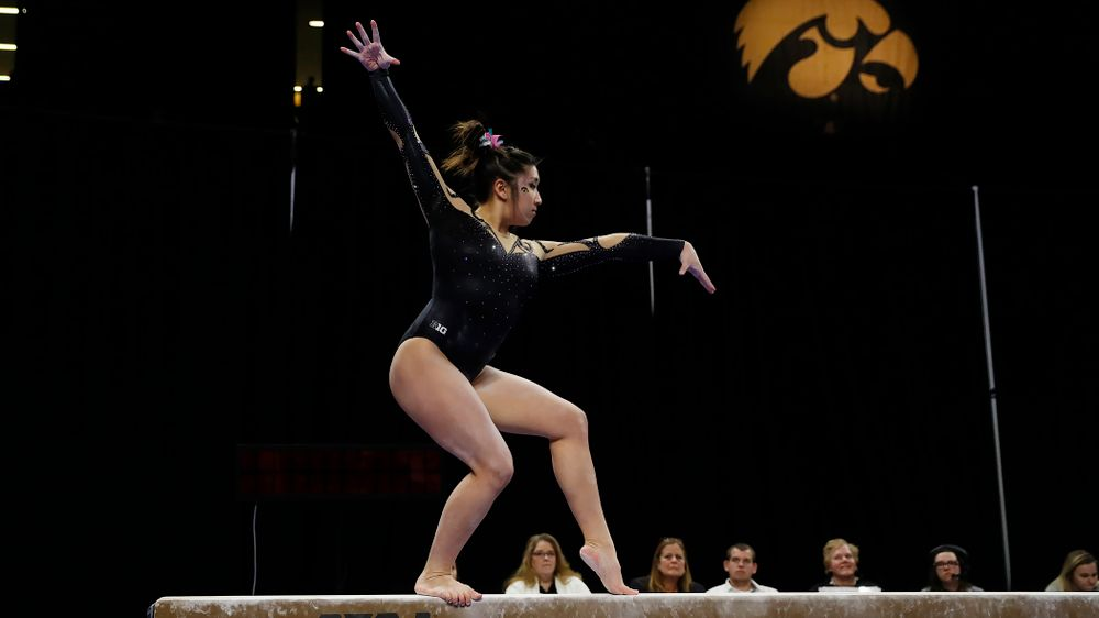 Nicole Chow competes on the beam