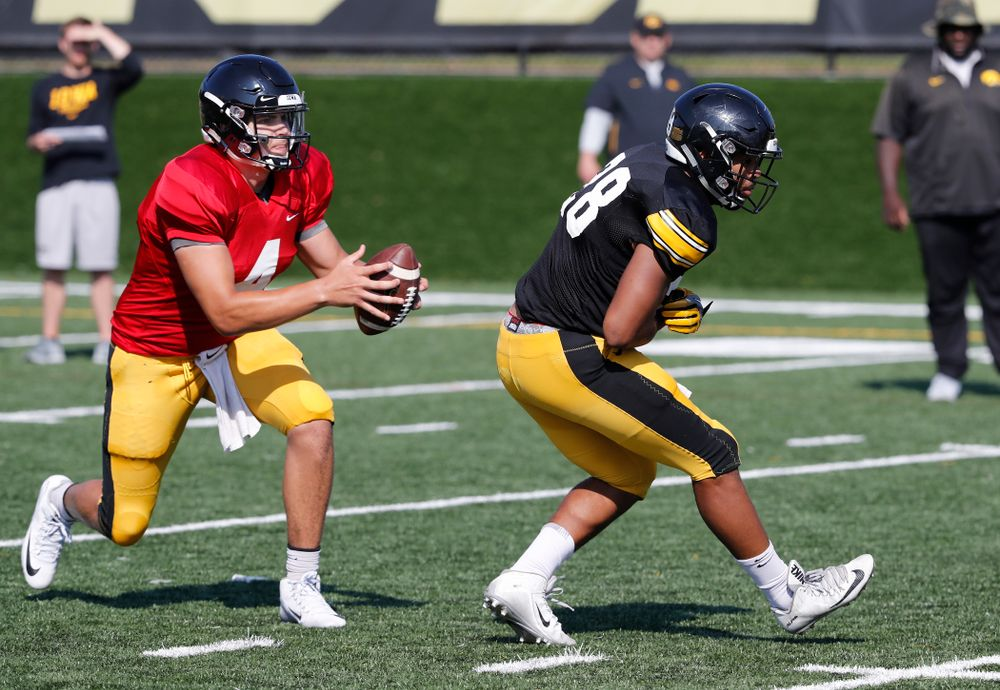 Iowa Hawkeyes quarterback Nathan Stanley (4) and running back Toren Young (28) during camp practice No. 17 Wednesday, August 22, 2018 at the Kenyon Football Practice Facility. (Brian Ray/hawkeyesports.com)