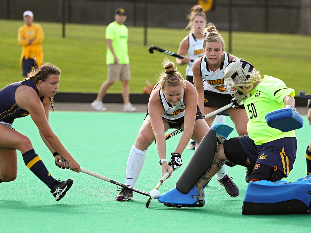 Iowa's Makenna Maguire (21) tries to get the ball past the Cal goalkeeper as Nikki Freeman (8) looks on during the third quarter of their game at Grant Field in Iowa City on Friday, Sep 13, 2019. (Stephen Mally/hawkeyesports.com)