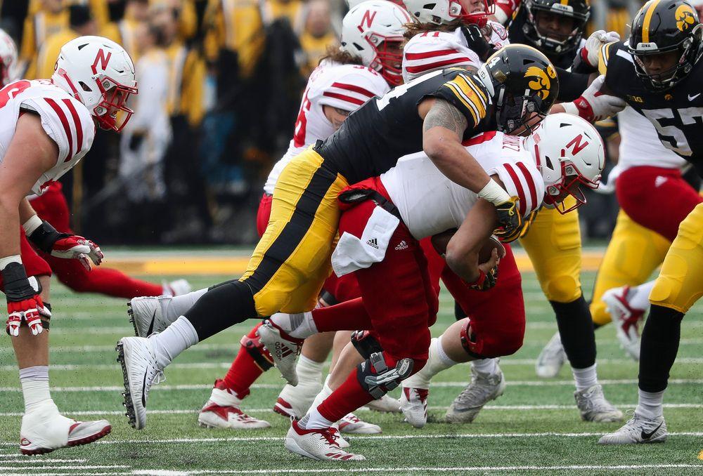 Iowa Hawkeyes defensive end A.J. Epenesa (94) sacks the quarterback during a game against Nebraska at Kinnick Stadium on November 23, 2018. (Tork Mason/hawkeyesports.com)