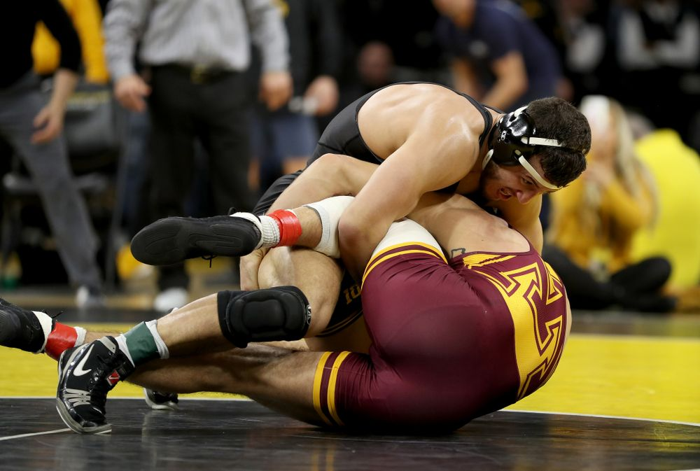 Iowa's Michael Kemerer wrestles Minnesota's Devin Skatzka at 174 pounds Saturday, February 15, 2020 at Carver-Hawkeye Arena. Kemererwon the match by fall. (Brian Ray/hawkeyesports.com)