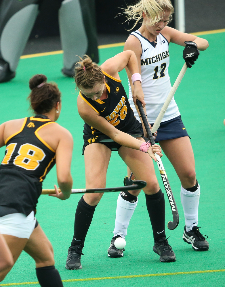 Iowa Hawkeyes forward Madeleine Murphy (26) fights for possession during a game against Michigan at Grant Field on October 5, 2018. (Tork Mason/hawkeyesports.com)