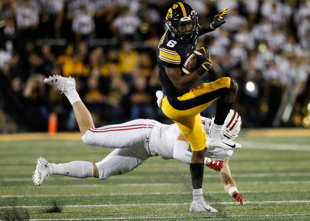 Iowa Hawkeyes wide receiver Ihmir Smith-Marsette (6) spins away from a tackle during a game against Wisconsin at Kinnick Stadium on September 22, 2018. (Tork Mason/hawkeyesports.com)