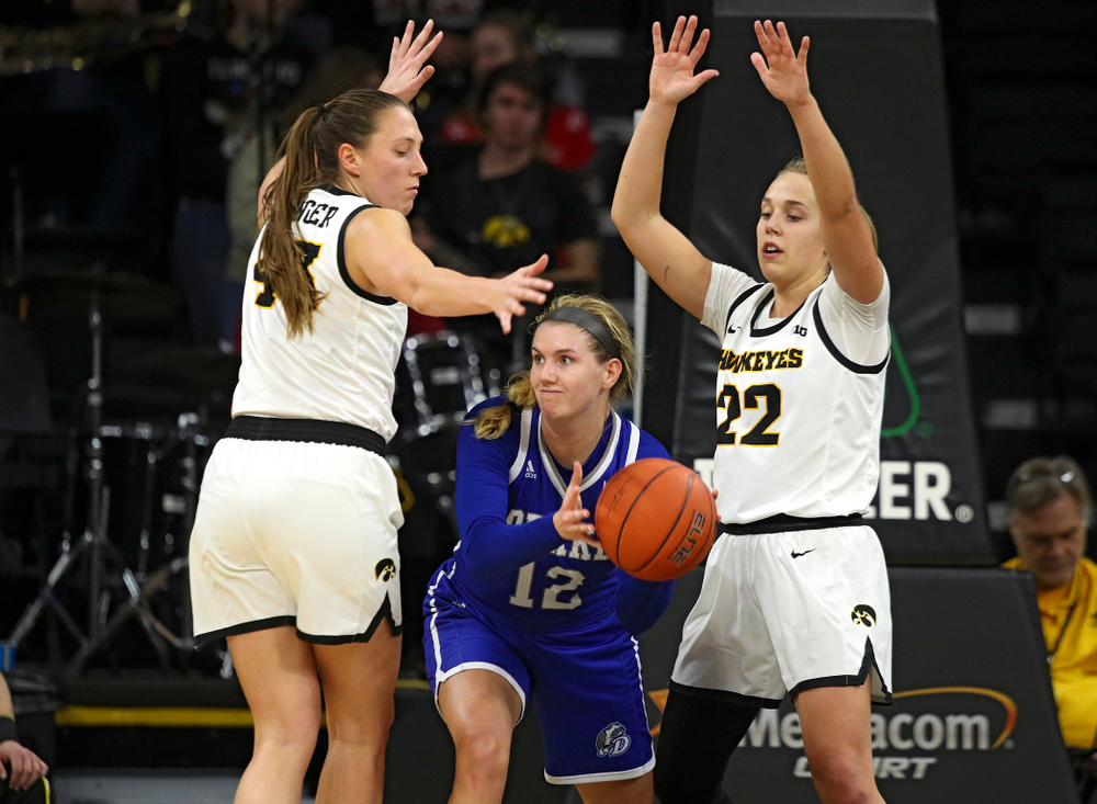 Iowa Hawkeyes forward Amanda Ollinger (43) and guard Kathleen Doyle (22) pressure Drake Bulldogs guard Brenni Rose (12) during the fourth quarter of their game at Carver-Hawkeye Arena in Iowa City on Saturday, December 21, 2019. (Stephen Mally/hawkeyesports.com)