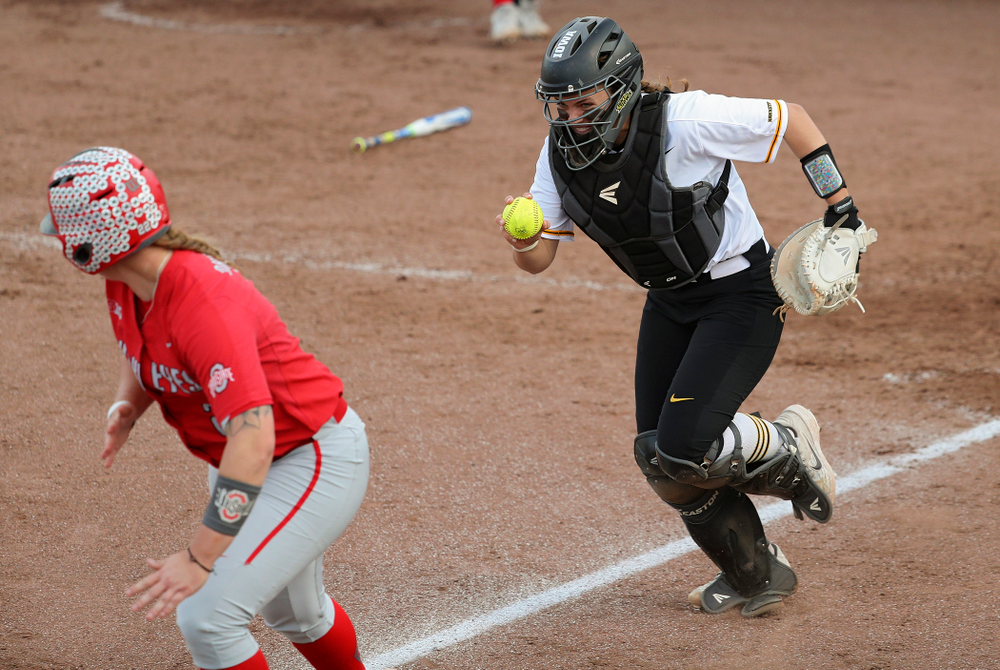 Iowa catcher Abby Lien (9) chases a runner back to third base after fielding a bunt during the sixth inning of their game against Ohio State at Pearl Field in Iowa City on Friday, May. 3, 2019. (Stephen Mally/hawkeyesports.com)