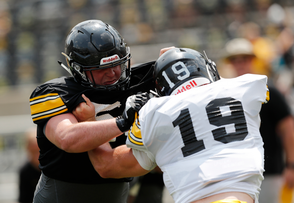 Iowa Hawkeyes offensive lineman Matt Fagan (54) and linebacker Mike Timm (19) during Kids Day Saturday, August 11, 2018 at Kinnick Stadium. (Brian Ray/hawkeyesports.com)