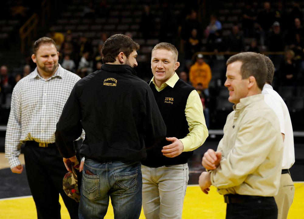 Iowa senior Logan McQuillen is recognized following their meet against Northwestern