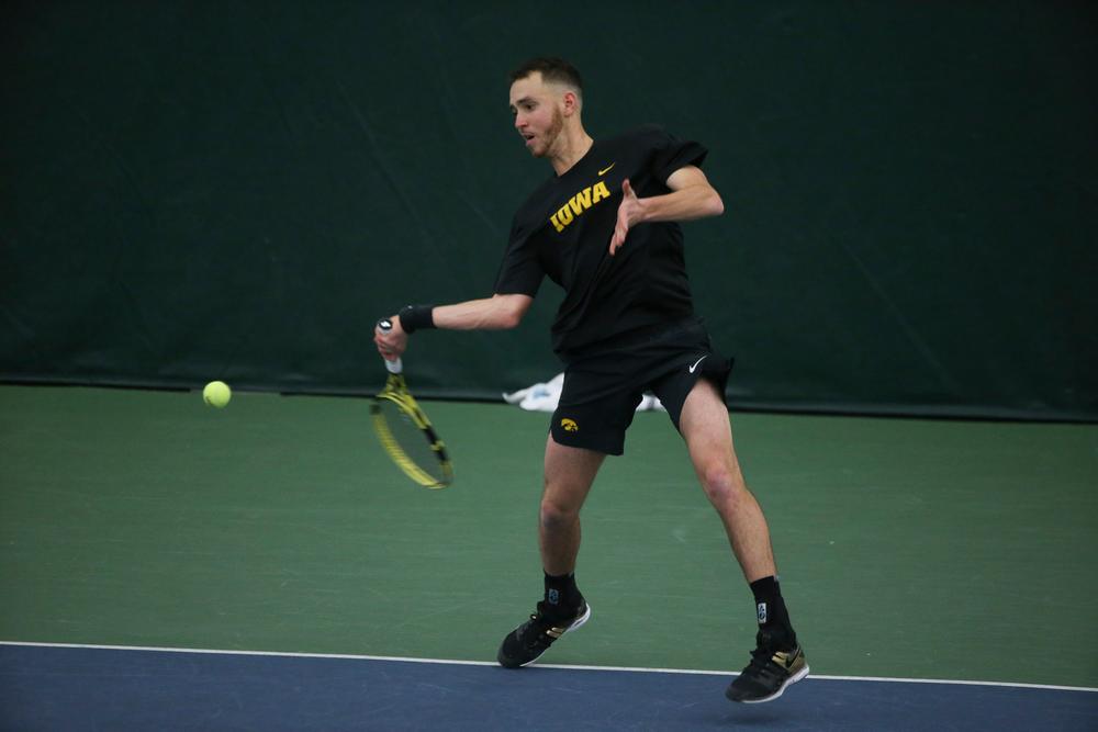 Iowa's Kareem Allaf returns a hit during the Iowa men's tennis meet vs VCU  on Saturday, February 29, 2020 at the Hawkeye Tennis and Recreation Complex. (Lily Smith/hawkeyesports.com)
