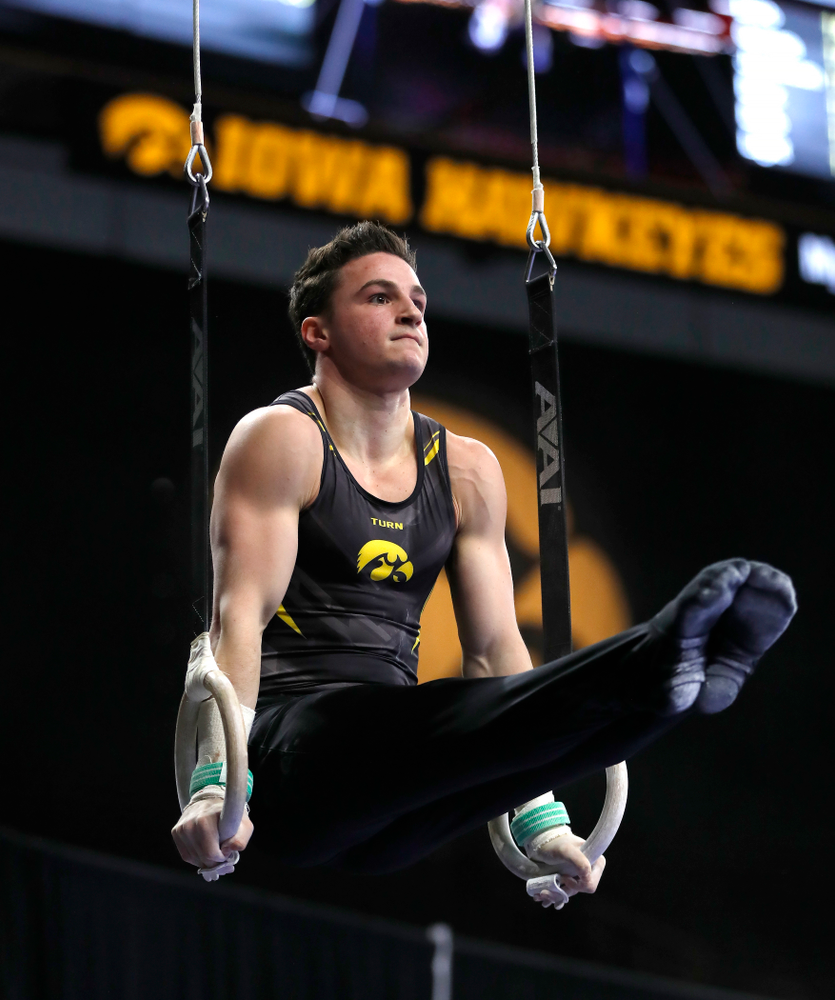 Jake Brodarzon competes on the rings against Illinois