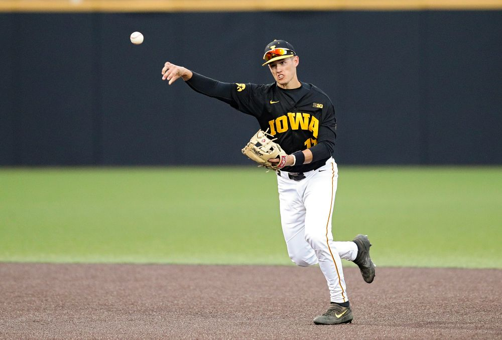 Iowa shortstop Dylan Nedved (17) throws to first for an out during the ninth inning of their college baseball game at Duane Banks Field in Iowa City on Tuesday, March 10, 2020. (Stephen Mally/hawkeyesports.com)