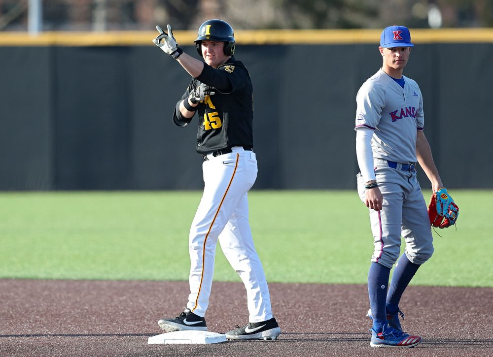 Iowa first baseman Peyton Williams (45) celebrates after hitting a double during the third inning of their college baseball game at Duane Banks Field in Iowa City on Tuesday, March 10, 2020. (Stephen Mally/hawkeyesports.com)