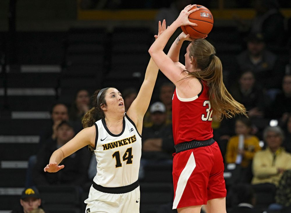 Iowa Hawkeyes guard McKenna Warnock (14) tries to block a shot during the third quarter of the game at Carver-Hawkeye Arena in Iowa City on Thursday, February 6, 2020. (Stephen Mally/hawkeyesports.com)