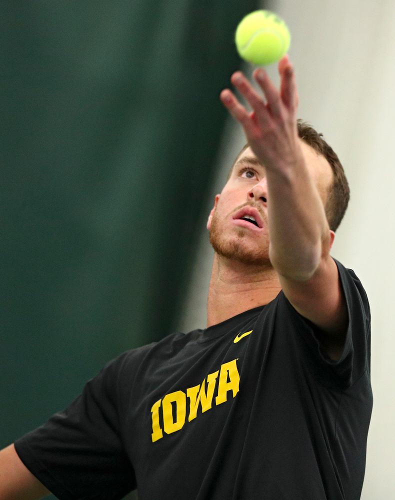 Iowa's Kareem Allaf serves during their match at the Hawkeye Tennis and Recreation Complex in Iowa City on Thursday, January 16, 2020. (Stephen Mally/hawkeyesports.com)