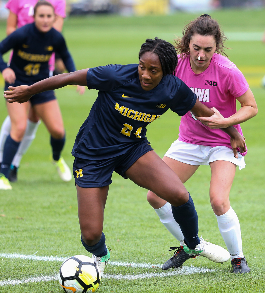 Iowa Hawkeyes forward Devin Burns (30) makes a tackle during a game against Michigan at the Iowa Soccer Complex on October 14, 2018. (Tork Mason/hawkeyesports.com)