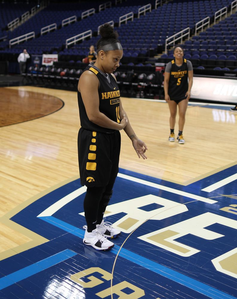 Iowa Hawkeyes guard Tania Davis (11) celebrates after sinking a half court shot during shoot around before their regional final against the Baylor Lady Bears in the 2019 NCAA Women's College Basketball Tournament Monday, April 1, 2019 at Greensboro Coliseum in Greensboro, NC.(Brian Ray/hawkeyesports.com)