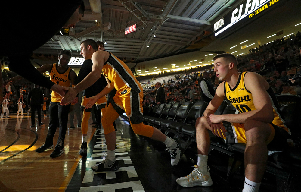 Iowa Hawkeyes guard Connor McCaffery (30) is introduced while guard Joe Wieskamp (10) waits before their game at Carver-Hawkeye Arena in Iowa City on Monday, Nov 11, 2019. (Stephen Mally/hawkeyesports.com)