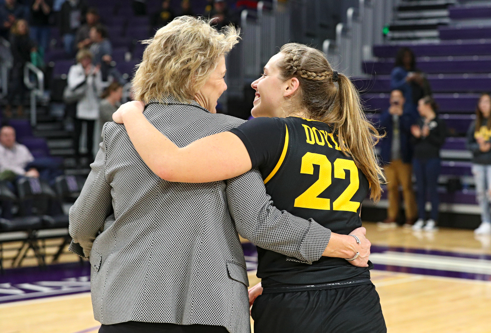 Iowa Hawkeyes head coach Lisa Bluder and guard Kathleen Doyle (22) share a laugh as they walk off the court after winning their game at Welsh-Ryan Arena in Evanston, Ill. on Sunday, January 5, 2020. (Stephen Mally/hawkeyesports.com)