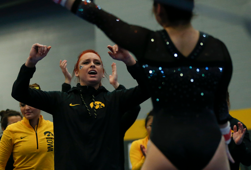 Maria Ortiz reacts after an uneven bar routine during the Black and Gold Intrasquad meet at the Field House on 12/2/17. (Tork Mason/hawkeyesports.com)