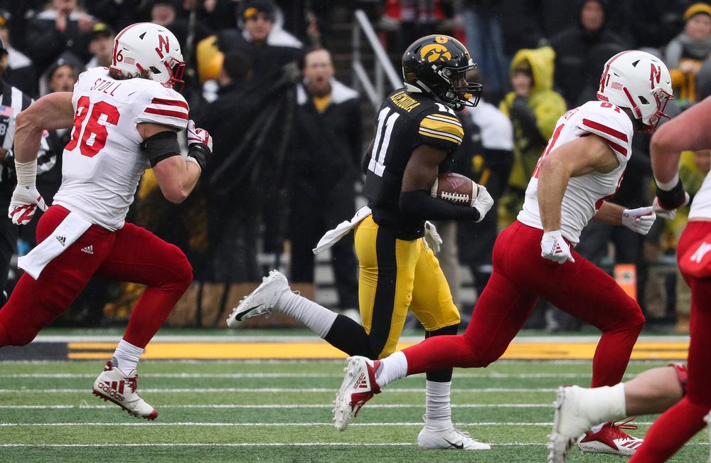 Iowa Hawkeyes defensive back Michael Ojemudia (11) returns an interception during a game against Nebraska at Kinnick Stadium on November 23, 2018. (Tork Mason/hawkeyesports.com)